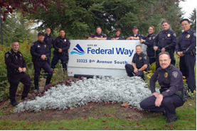 Officers standing by sign